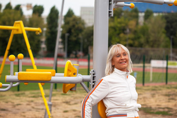 Adult woman smiling in fitness center