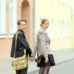 Stylish young hipster couple walking down the street