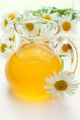 Jar with honey and chamomile
