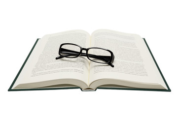 Folded Eyeglasses On Opened Book Isolated On White