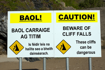 beware of cliff falls warning sign