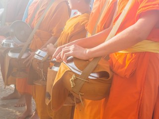 Buddhist monks waiting for food offering in morning, Thailand
