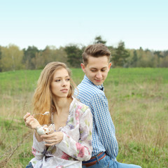 Pretty nice young couple eating ice cream outdoors