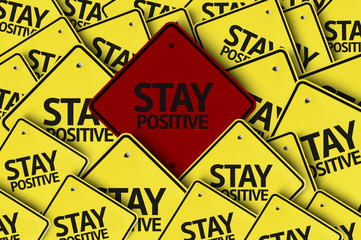 Stay Positive written on multiple road sign