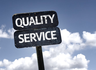 Quality Service sign with clouds and sky background