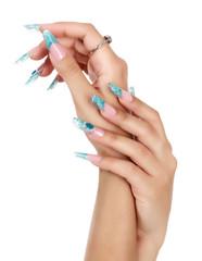 Female hand with long fingernails