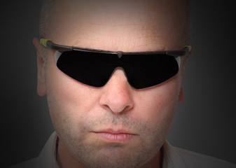 Portrait of man with sunglasses.  Agent in action.