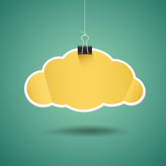 Yellow paper cloud shape origami with binder clip