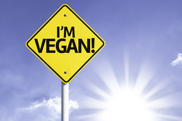 I'm Vegan! road sign with sun background
