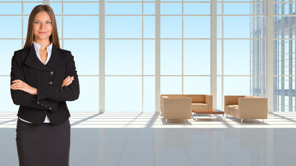 Businesswoman and large window in office building