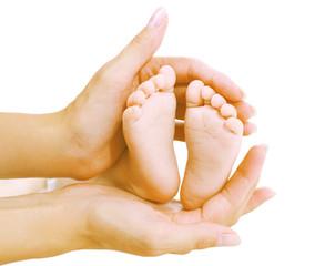 Baby feet in hands mother