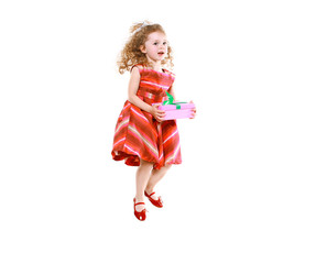 Cheerful little girl jumping with a gift
