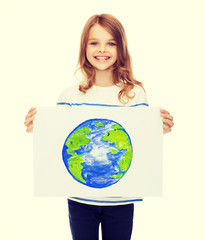 smiling little child holding picture of planet