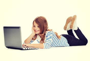 smiling student girl with laptop computer lying