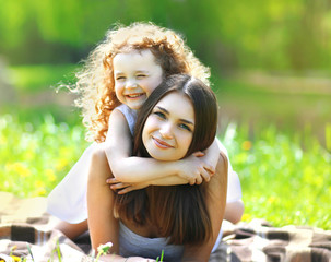 Portrait beautiful mom and daughter resting in summer day