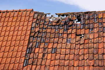 Damaged tiled roof of an old Dutch house
