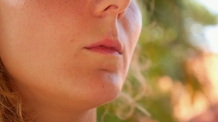 Closeup of Young Woman Smoking.