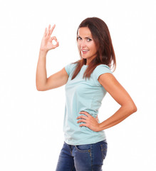 Adult hispanic woman with ok sign