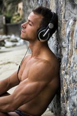 Solitary man lon the beach listening to music