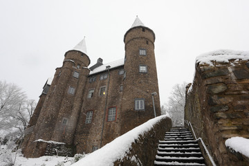 Snow-covered ancient castle in town Herborn, Hesse, Germany
