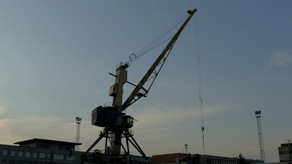 Big crane on standby on a dusky afternoon in the port GH4 4K UHD