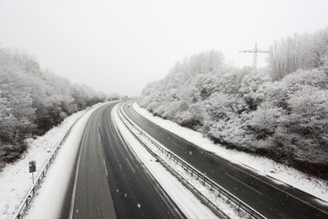 German highway during a heavy snowstorm in winter