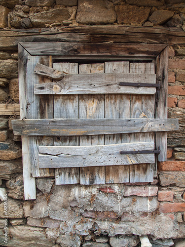 canvas print picture old rotten hatch in a rustic brick wall