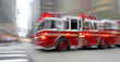canvas print picture - fire trucks and firefighters brigade in the city