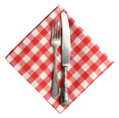 Vintage knife and fork on red plaid linen napkin isolated.