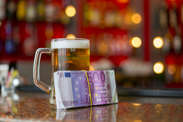 mug of beer and money