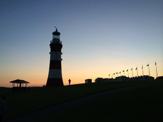 lighthouse tower at sunset in plymouth england