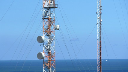 Two tall telecommunication towers GH4 4K UHD