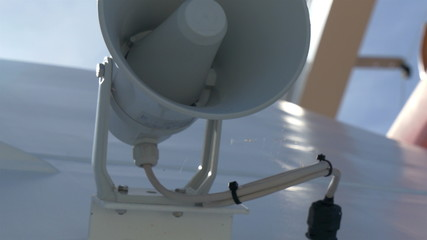 A white small megaphone attached on the yacht GH4 4K UHD