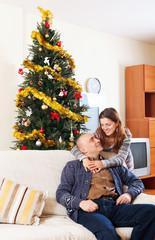 Couple near a Christmas tree