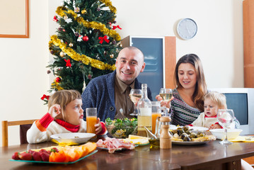 Happy family at Christmas table