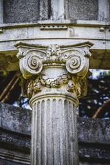 ancient, Greek-style columns, Corinthian capitals in a park