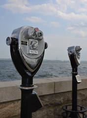A coin-operated binocular viewer