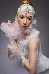 Beautiful woman in white corset
