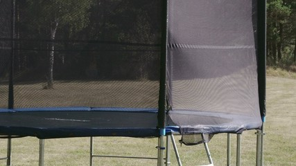 A small size trampoline on the backyard Sony FS700 Odyssey 7Q 4K