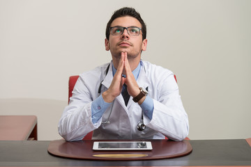 Young Doctor Man With Problems In The Office