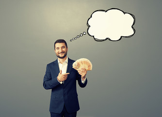 man with speech bubble and money