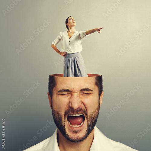 stressed screaming man and smiley woman