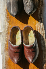 traditional wooden shoes hanging on a wall