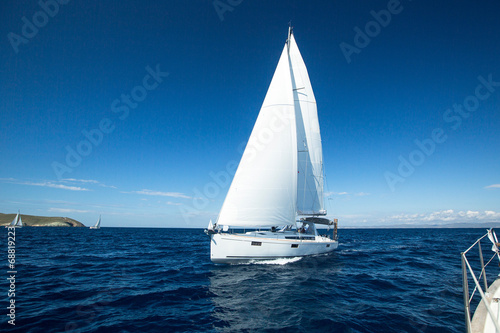 Yacht sailing at competition. - 68819223