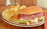 Roast beef sandwich with potato chips