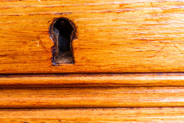 keyhole of luxurious wooden cabinet