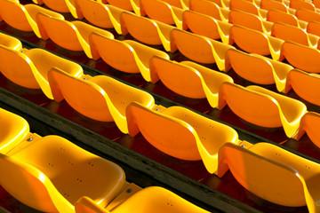empty yellow seats at sports stadium