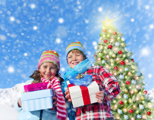 Children Holding Gift Boxes with Christmas Tree