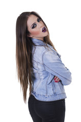 Gorgeous young rebel long haired girl with intense makeup