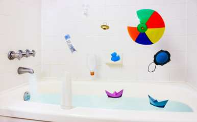 Fun in bathroom, falling toys